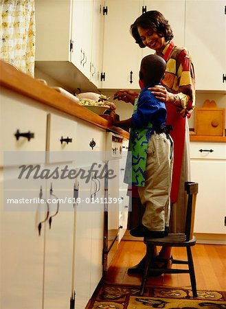 Mother and Son Cooking in the Kitchen Stock Photo - Premium Royalty-Free, Image code: 618-01411399