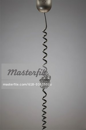 Entangled telephone cord Stock Photo - Premium Royalty-Free, Image code: 618-01639326