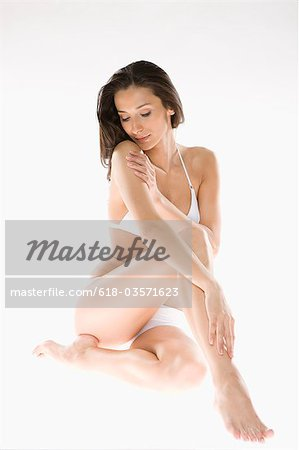 Woman in Underwear Stock Photo - Premium Royalty-Free, Image code: 618-03571623