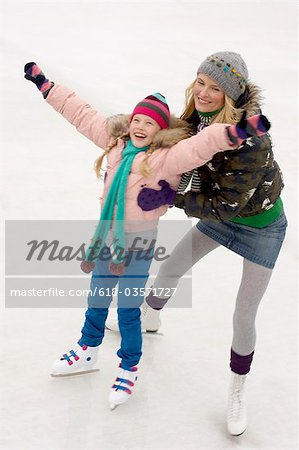 Mother and daughter ice skating Stock Photo - Premium Royalty-Free, Image code: 618-03571727