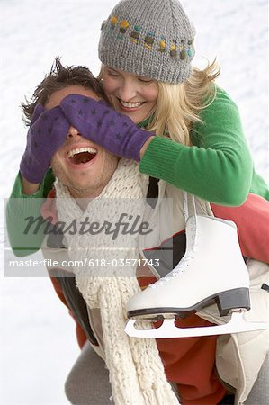 Couple with ice skates playing Stock Photo - Premium Royalty-Free, Image code: 618-03571743