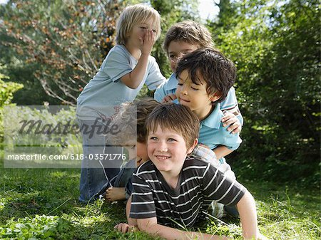 Young playful boys lying on top of each other Stock Photo - Premium Royalty-Free, Image code: 618-03571776