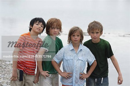 Portrait of four wet boys standing at pond Stock Photo - Premium Royalty-Free, Image code: 618-03571786