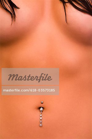 Torso of woman with navel dangle Stock Photo - Premium Royalty-Free, Image code: 618-03573185