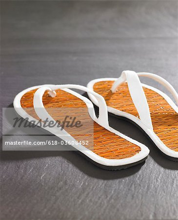 flip-flops on slate Stock Photo - Premium Royalty-Free, Image code: 618-03608452
