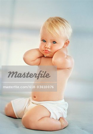 Portrait of a funny pouting baby girl Stock Photo - Premium Royalty-Free, Image code: 618-03610076