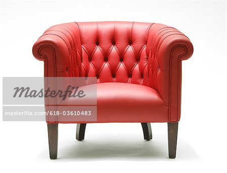 Bright red leather chair Stock Photo - Premium Royalty-Free, Image code: 618-03610483