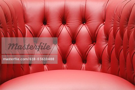 Bright red leather chair section Stock Photo - Premium Royalty-Free, Image code: 618-03610488