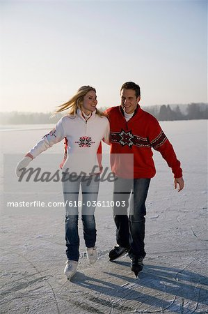 Couple ice skating together, front view Stock Photo - Premium Royalty-Free, Image code: 618-03611003