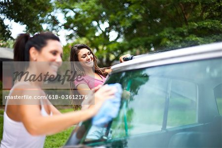 Mother daughter washing car Stock Photo - Premium Royalty-Free, Image code: 618-03612176
