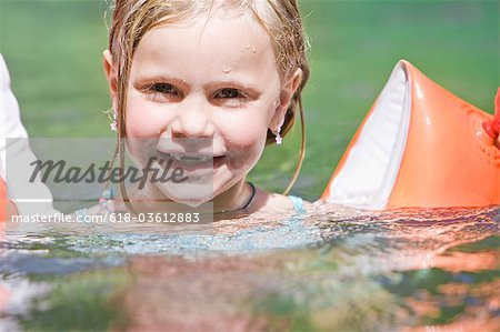 A young girl wearing armbands Stock Photo - Premium Royalty-Free, Image code: 618-03612883