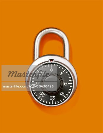 Combination lock or padlock closed and alone Stock Photo - Premium Royalty-Free, Image code: 618-03630496