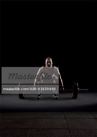 Weightlifter preparing to lift weight Stock Photo - Premium Royalty-Free, Image code: 618-03630690