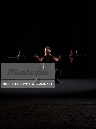 Weigthlifter beginnig to lift weight Stock Photo - Premium Royalty-Free, Image code: 618-03630691