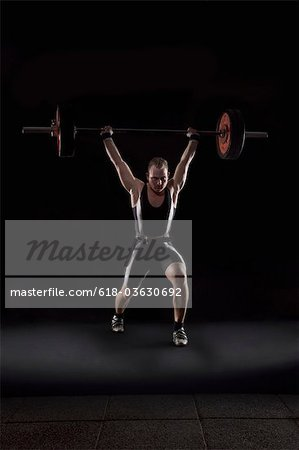 Weightlifter with heavy weight Stock Photo - Premium Royalty-Free, Image code: 618-03630692