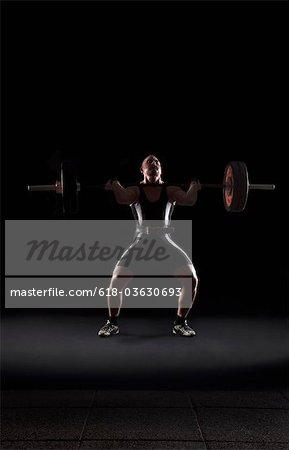 Weightlifter jerking weight Stock Photo - Premium Royalty-Free, Image code: 618-03630693