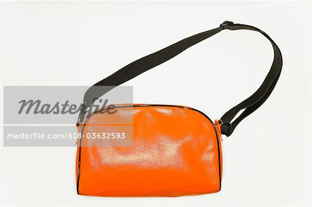 An orange shoulder bag Stock Photo - Premium Royalty-Free, Image code: 618-03632593