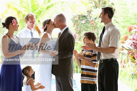 Newly married couple kissing after cerimony. Stock Photo - Premium Royalty-Free, Image code: 618-03632868