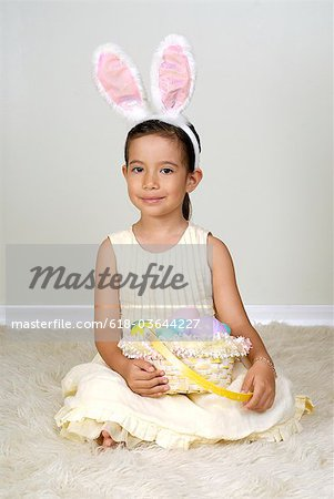 Young girl (4-5) in easter bunny costume, portrait Stock Photo - Premium Royalty-Free, Image code: 618-03644227