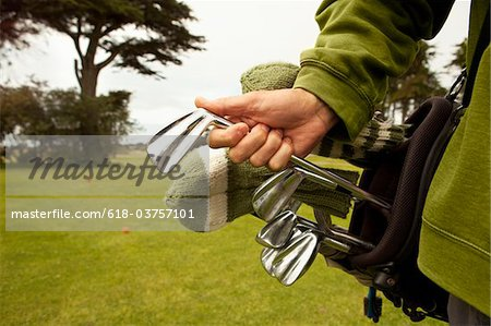 Golfer with Vintage Clubs. Stock Photo - Premium Royalty-Free, Image code: 618-03757101