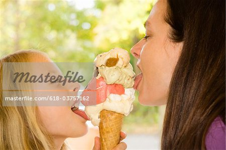 A mother and daughter sharing an ice cream Stock Photo - Premium Royalty-Free, Image code: 618-03757162