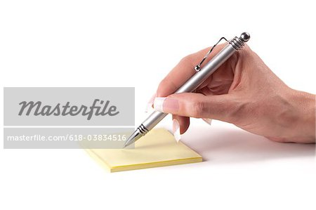 Hand with post-it note Stock Photo - Premium Royalty-Free, Image code: 618-03834516