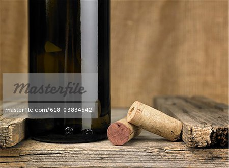 Wine bottles and corks in a cellar Stock Photo - Premium Royalty-Free, Image code: 618-03834542