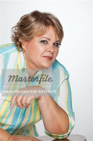 Portrait of overweight woman Stock Photo - Premium Royalty-Free, Image code: 618-04251509