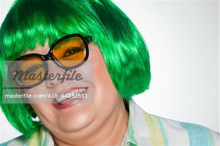 Overweight woman with green wig and sunglasses Stock Photo - Premium Royalty-Free, Image code: 618-04251551