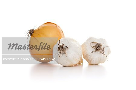 Garlic and raw potato Stock Photo - Premium Royalty-Free, Image code: 618-05450852