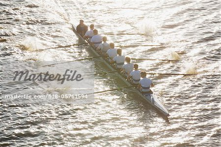 People oaring canoe during competition Stock Photo - Premium Royalty-Free, Image code: 618-05761594