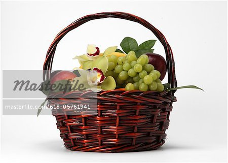 A basket of fruit and flowers Stock Photo - Premium Royalty-Free, Image code: 618-05761941