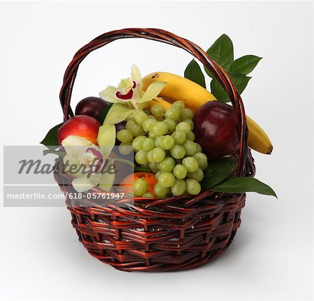 A basket of fruit and flowers Stock Photo - Premium Royalty-Free, Image code: 618-05761947
