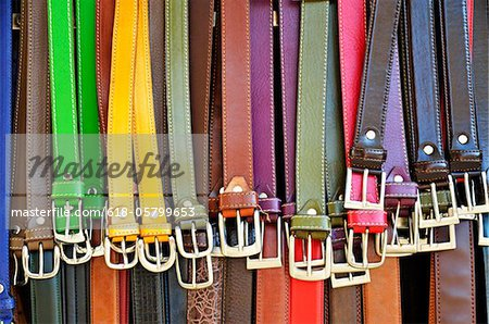 Hanging colorful leather belts at shop Stock Photo - Premium Royalty-Free, Image code: 618-05799653