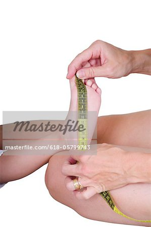 measuring growth Stock Photo - Premium Royalty-Free, Image code: 618-05799743