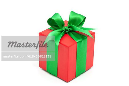 red gift box with green bow Stock Photo - Premium Royalty-Free, Image code: 618-05818135