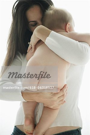 mother holding naked baby. Stock Photo - Premium Royalty-Free, Image code: 618-06318937