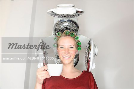 girl with curler under hair dryer Stock Photo - Premium Royalty-Free, Image code: 618-06346335