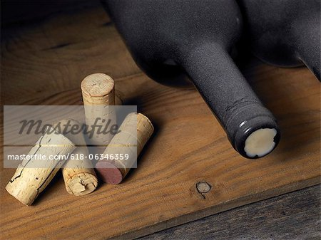 Wine bottles and corks in a cellar Stock Photo - Premium Royalty-Free, Image code: 618-06346359