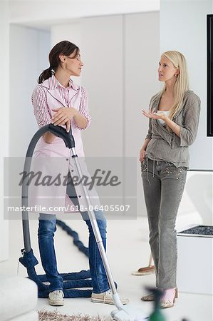 Mature woman talking to cleaner in home Stock Photo - Premium Royalty-Free, Image code: 618-06405507