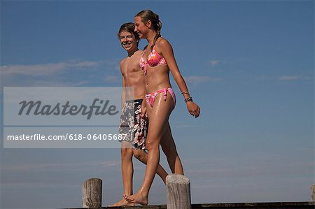 Young teenage couple walking along pier Stock Photo - Premium Royalty-Free, Image code: 618-06405687