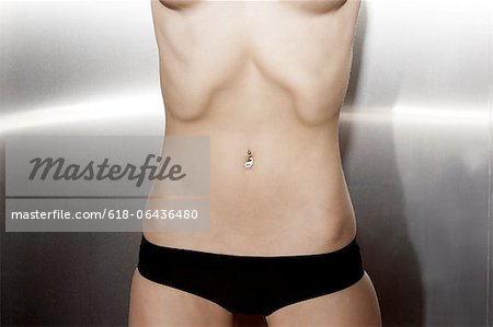 Naked Woman With Navel Piercing Stock Photo - Premium Royalty-Free, Image code: 618-06436480