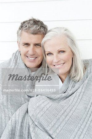 Senior Couple Wrapped In Blanket Stock Photo - Premium Royalty-Free, Image code: 618-06436493