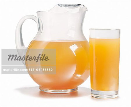Pitcher and glass full of fresh orange juice Stock Photo - Premium Royalty-Free, Image code: 618-06436580
