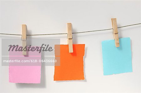 Blank notes on laundry clothesline Stock Photo - Premium Royalty-Free, Image code: 618-06436660