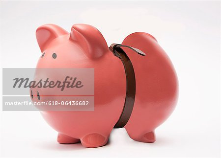 piggybank tightening the belt Stock Photo - Premium Royalty-Free, Image code: 618-06436682
