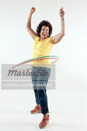 Mature Women Hula Hooping Stock Photo - Premium Royalty-Free, Image code: 618-06436723