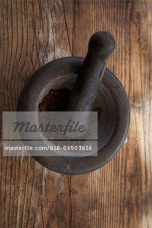 Mortar with pimento Stock Photo - Premium Royalty-Free, Image code: 618-06503616