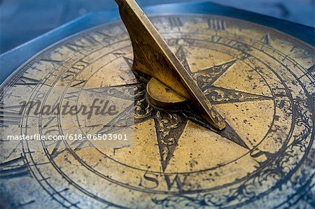Antique brass sun dial Stock Photo - Premium Royalty-Free, Image code: 618-06503901