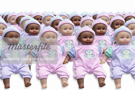 Rows of mixed race identical dolls